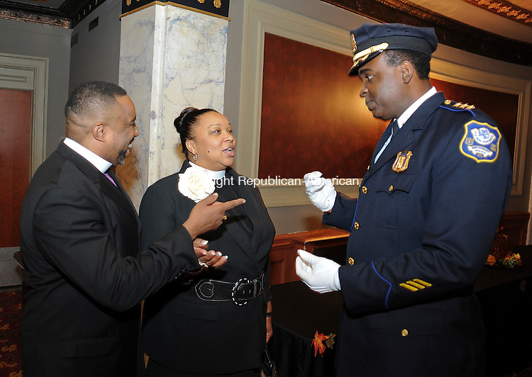 WATERBURY, CT 04 OCTOBER 2013--100413JS05-Waterbury Police Chief Vernon L. Riddick Jr., right chats with Bishop T. Charles Brantley, left and Pastor Jackie Brantley of the Restoration Springs of Waterbury prior to his swearing in ceremony Friday at the Palace Theater in Waterbury. <br /> Jim Shannon Republican American