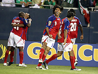 Costa Rica's Alvaro Saborio lets out a scream as Costa Rican players celebrate Froylan Ledezma's (21) goal at the end of stoppage time in the second half to tie the game 1-1.  Mexico defeated Costa Rica 2-1 on penalty kicks in the semifinals of the Gold Cup at Soldier Field in Chicago, IL on July 23, 2009.