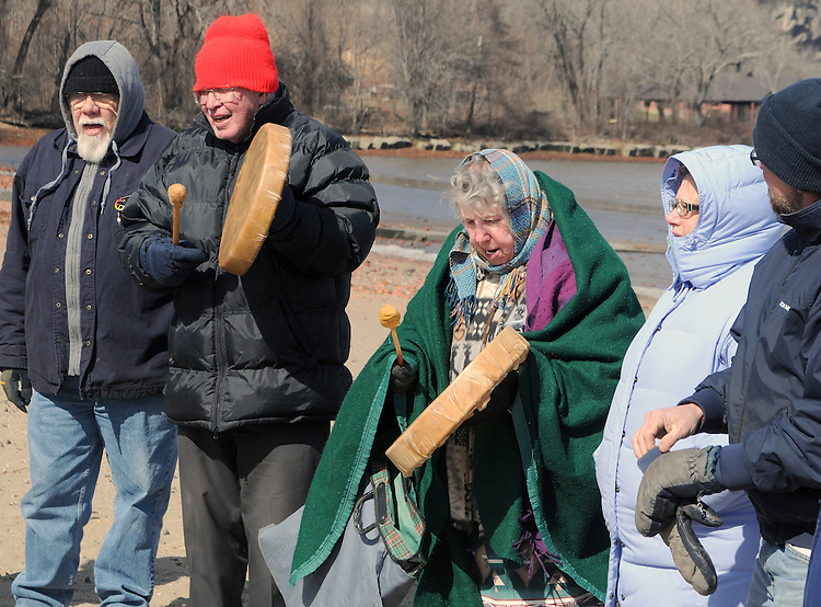 Evan Pritchard, (Micmac), in grey hood; Etaoqua (Mahicanu), wearing green shawl; and, Nick Miles (Pamunkey, Powhatan), wearing red hat, representing the Assn of Native American of the Hudson Valley, seen leading a Native American Water Blessing Ceremony held for the Hudson River at Kingston Point Beach in Kingston, NY, on Saturday, March 4, 2017. Photo by Jim Peppler; Copyright Jim Peppler 2017