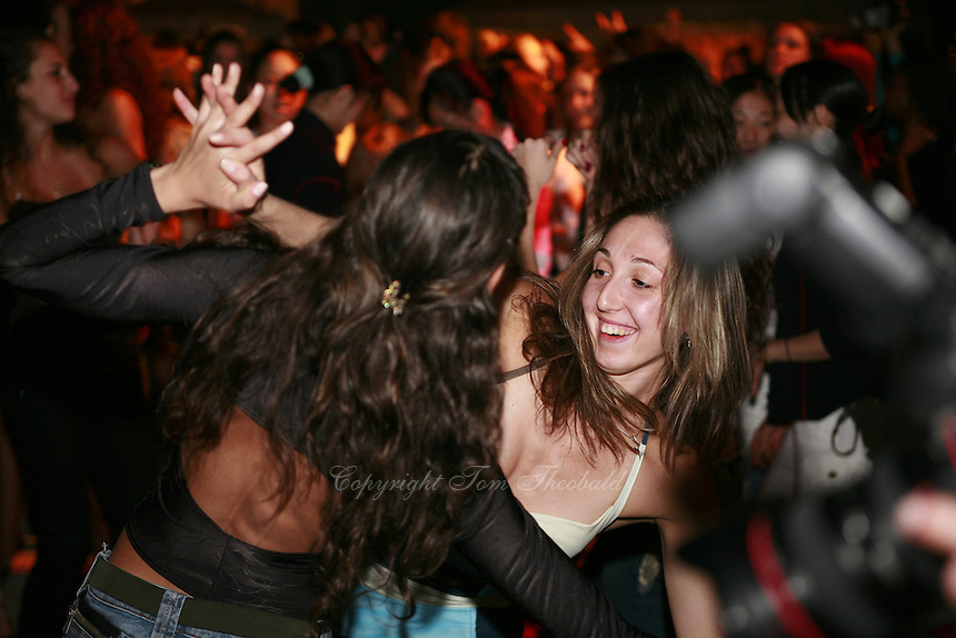 September 23, 2007; Patras, Greece;  (R) Elizabeth Paisieva and (L, back to camera) Stela Sultanova of Bulgaria dance the night away at banquet after 2007 World Championships Patras.  Photo by Tom Theobald. ...