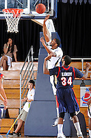 25 February 2012:  FIU center Brandon Moore (22) shoots over South Alabama guard-forward Antione Lundy (34) in the first half as the FIU Golden Panthers defeated the University of South Alabama Jaguars, 81-74, at the U.S. Century Bank Arena in Miami, Florida.