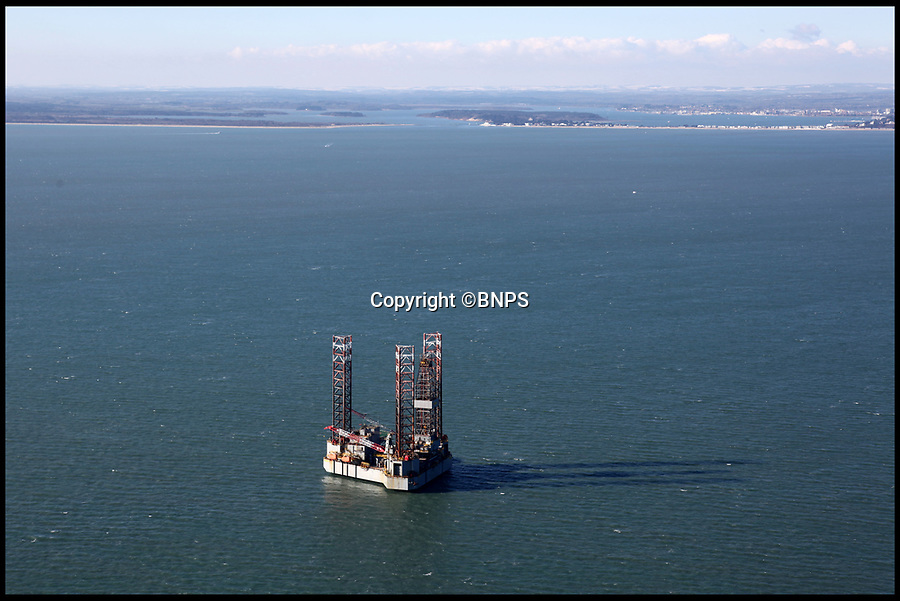 BNPS.co.uk (01202 558833)<br /> Pic: BNPS<br /> <br /> A controversial oil rig has been positioned between two of Britain's most famous coastal landmarks to begin a test drilling on a deepwater well.<br /> <br /> The ENSCO 72 rig has been given government permission to spend 40 days digging an appraisal well for oil in Poole Bay, Dorset, which forms part of the Jurassic Coast UNESCO World Heritage Site.<br /> <br /> The 340ft high platform stands four miles east of the popular beauty spot of Old Harry Rocks, near Swanage, and 10 miles west of the Needles on the Isle of Wight.<br /> <br /> Its arrival has sparked anger with not only environmentalists but also many residents of Bournemouth who can clearly see the 250ft wide platform from its famous seafront.