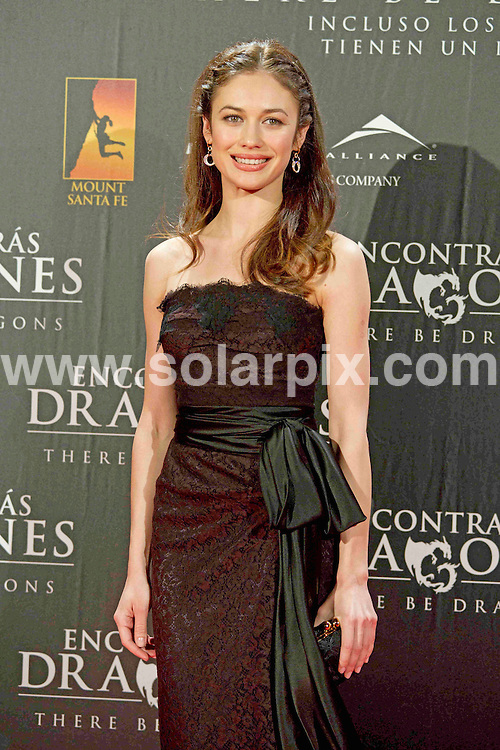 **ALL ROUND PICTURES FROM SOLARPIX.COM**                                             **WORLDWIDE SYNDICATION RIGHTS EXCEPT SPAIN - NO SYNDICATION IN SPAIN**                                                                                  Caption: attends There Be Dragons (Encontraras Dragones) premiere at Capitol cinema in Madrid, Spain. March 23, 2011                                                                    This pic:  Olga Kurylenko                                                                                            JOB REF: 13018 DMS       DATE: 23_03_2011                                                           **MUST CREDIT SOLARPIX.COM OR DOUBLE FEE WILL BE CHARGED**                                                                      **MUST AGREE FEE BEFORE ONLINE USAGE**                               **CALL US ON: +34 952 811 768 or LOW RATE FROM UK 0844 617 7637**