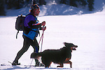 Man snowshoeing with his dog at Castle Peak