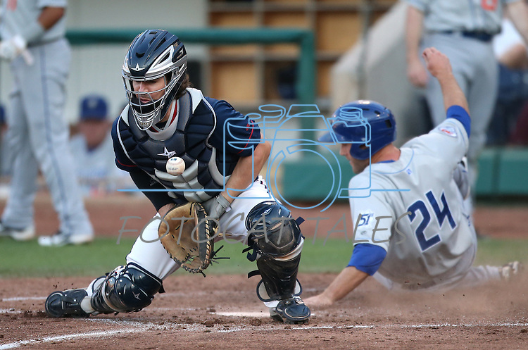 Las Vegas 51s' Eric Campbell scores past Reno Aces' catcher Tuffy Gosewisch during a Triple-A baseball game in Reno, Nev., on Sunday, July 21, 2013. The 51s won 15-8.<br /> Photo by Cathleen Allison