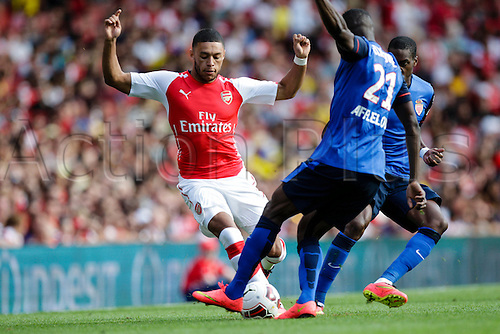 03.08.2014. London, England. Emirates Cup.  Arsenal versus AS Monaco.  Arsenal forward Alex OXLADE-CHAMBERLAIN takes on AS Monaco's Elderson ECHIEJILE  With Monaco winning 0-1 and Valencia winning earlier in the day, Valencia won the tournament trophy.