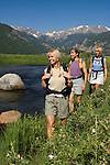 Girlfriends hike near the Big Thompson River at Moraine Park on a clear, blue-sky summer morning in Rocky Mountain National Park, Colorado (MR#85)
