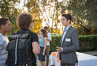 """Occidental College student Brandyn """"Cole"""" Moniz '16 shares his InternLA experience working at DineEquity during the Career Development Center's Reverse Career Fair, Thorne Hall patio, Sept. 3, 2015.<br /> (Photo by Marc Campos, Occidental College Photographer)"""