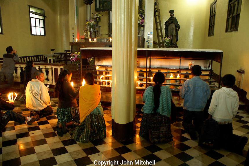 Maya people kneeling and praying in Templo El Calvario church in Coban, Alta Verapaz, Guatemala