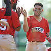 Antonio Diaz #7, Freeport first baseman, right, gets congratulated by Justin Lake #25 after crossing home plate in the bottom of the first inning of a Nassau County varsity baseball game against Uniondale at Cleveland Avenue Field on Wednesday, May 11, 2016. Freeport scored eight times in the frame.