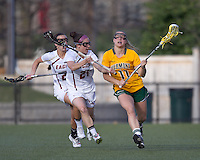University of Vermont midfielder Karli Mackendrick (11) brings the ball forward as Boston College midfielder Kristin Igoe (21) defends. Boston College defeated University of Vermont, 15-9, at Newton Campus Field, April 4, 2012.