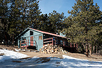 A home in Pinewoods Springs near the Arapahoe-Roosevelt National Forest in Pinewood Springs, Colorado, Wednesday, February 1, 2012. National Forests in Colorado could, under rule making now going on in the Obama administration, have much reduced protections from development than the rest of the nation under the so-called roadless rules, proposed in the Clinton administration, and recently vindicated by a federal appeals panel..Photo by Matt Nager