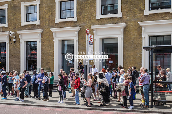 People waiting for a bus in Borough, Southwark, London.