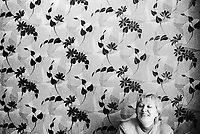 Belarus. Province of Gomel. Bolchevik. Day nursery for children. Portrait of the director Irina Petrowka . Wallpaper with flowers. Many children suffer physical health problems due to the Chernobyl disaster. The village of Bolchevik was heavily affected by the fallout of the catastrophe which took place on april 1986 at 1.23 am in the Chernobyl atomic power station. The accident in the nuclear power plant has environmentals effects which affect territories and health of the people. The village of Bolchevik is still contamined by radioactive materials, like caesium 137. © 2006 Didier Ruef