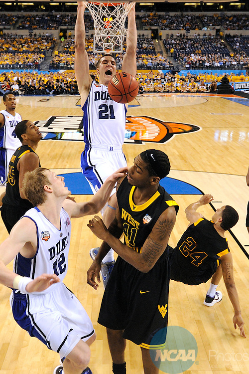 3 APR 2010: Miles Plumlee (21) of Duke slam dunks an offensive rebound during the semi final game of the Men's Final Four Basketball Championships held at Lucas Oil Stadium in Indianapolis, IN. Duke went on to defeat West Virginia 78-57 to advance to the championship game. Chris Steppig/NCAA Photos