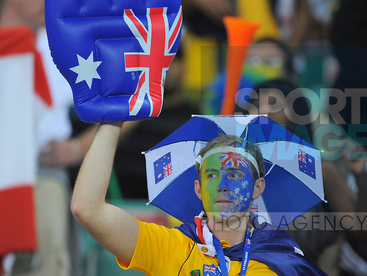 An Australian fan joins in the pre match celebrations