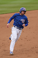 Iowa Cubs outfielder Mike Baxter (7) rounds third base during a Pacific Coast League game against the Colorado Springs Sky Sox on May 11th, 2015 at Principal Park in Des Moines, Iowa.  Colorado Springs defeated Iowa 13-7.  (Brad Krause/Four Seam Images)