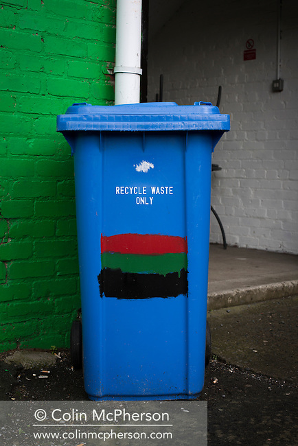 A refuse bin painted in club colours at The Oval, Belfast, pictured before Glentoran hosted city-rivals Cliftonville in an NIFL Premiership match. Glentoran, formed in 1892, have been based at The Oval since their formation and are historically one of Northern Ireland's 'big two' football clubs. They had an unprecendentally bad start to the 2016-17 league campaign, but came from behind to win this fixture 2-1, watched by a crowd of 1872.