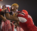 Louisville Cardinals quarterback Teddy Bridgewater (5) was kissed by his mom after winning the MVP trophy as the Louisville Cardinals defeated the Miami Hurricanes 36-9 in the Russell Athletic Bowl in Orlando, Fl. on December 28, 2013.  Photo by Mark Mahan