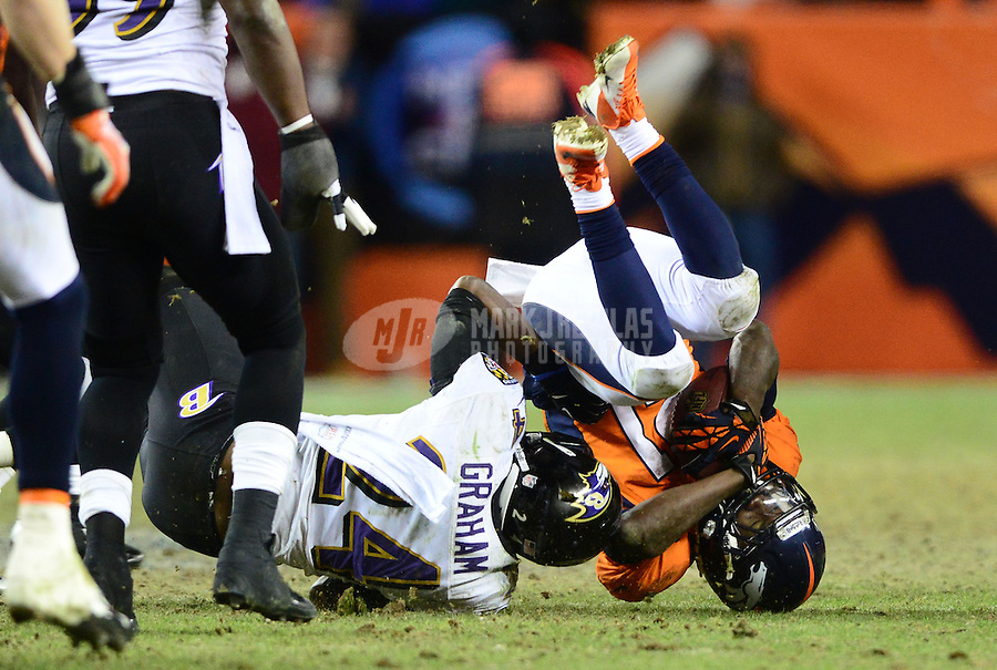 Jan 12, 2013; Denver, CO, USA; Baltimore Ravens cornerback Corey Graham (24) tackles Denver Broncos running back Ronnie Hillman (21) during the AFC divisional round playoff game at Sports Authority Field.  Mandatory Credit: Mark J. Rebilas-