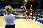21 March 2014: Oklahoma head coach Sherri Coale (left) watches her team practice. The University of Oklahoma Sooners held a training session the day before playing in an NCAA Division I Women's Basketball Tournament First Round game at Cameron Indoor Stadium in Durham, North Carolina.