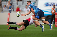 March 14th 2020, Eden Park, Auckland, New Zealand;  Blues Dalton Papalii passes off as he is tackled against the Lions during the Super Rugby match between the Blues and the Lions, held at Eden Park, Auckland, New Zealand.