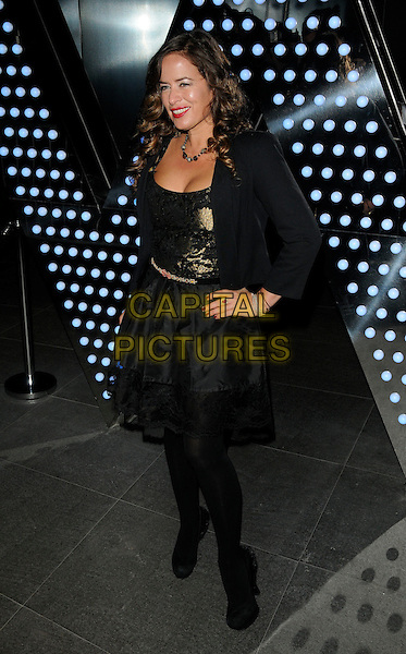 JADE JAGGER.The W London Leicester Square hotel launch party, Wardour St., London, England..March 16th, 2011.full length black tights silk satin dress shoes jacket hand on hip gold embroidery belt .CAP/CAN.©Can Nguyen/Capital Pictures.