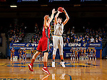 BROOKINGS, SD - DECEMBER 31:  Mike Daum #24 from South Dakota State University shoots a three pointer against the University of South Dakota during their game Saturday afternoon at Frost Arena in Brookings. (Dave Eggen/Inertia)