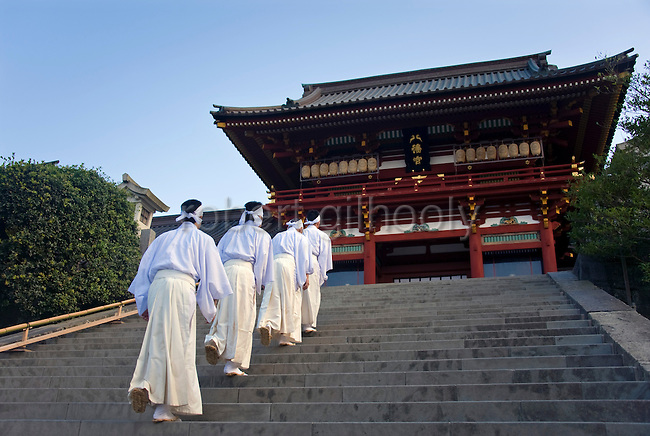 Shrine officials walk up the 61 steps leading up to the inner sanctuary  during the annual Reitaisai Grand Festival at Tsurugaoka Hachimangu Shrine in Kamakura, Japan on  14 Sept. 2012.  Sept 14 marks the first day of the 3-day Reitaisai festival, which starts early in the morning when shrine priests and officials perform a purification ritual in the ocean during a rite known as hamaorisai and limaxes with a display of yabusame horseback archery. Photographer: Robert Gilhooly