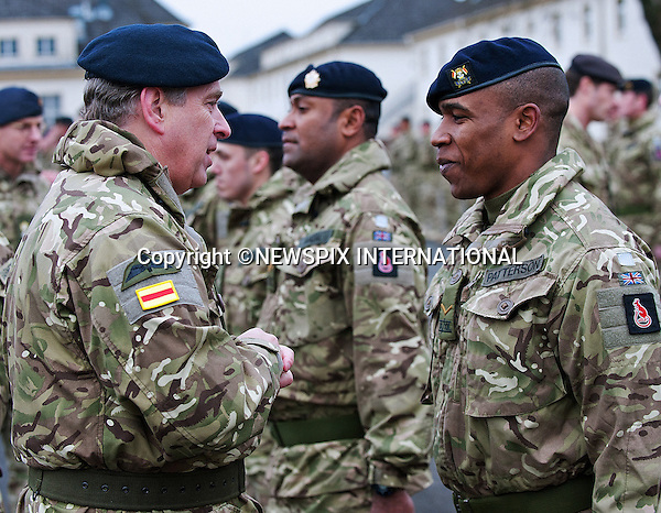 "PRINCE ANDREW.presented campaign medals to personnel from 9th/12th Royal Lancers following their return from a demanding six-month tour in Afghanistan..The Duke of York, Colonel-in-Chief of 9th/12th Royal Lancers presented medals to members of the unit during a ceremony at their home barracks in Bergen-Hohne in northern Germany before attending a specially arranged reception with military personnel and their families_08/12/2011.Photo Credit: ©Obi Igbo/Newspix International..**ALL FEES PAYABLE TO: ""NEWSPIX INTERNATIONAL""**..PHOTO CREDIT MANDATORY!!: NEWSPIX INTERNATIONAL..IMMEDIATE CONFIRMATION OF USAGE REQUIRED:.Newspix International, 31 Chinnery Hill, Bishop's Stortford, ENGLAND CM23 3PS.Tel:+441279 324672  ; Fax: +441279656877.Mobile:  0777568 1153.e-mail: info@newspixinternational.co.uk"