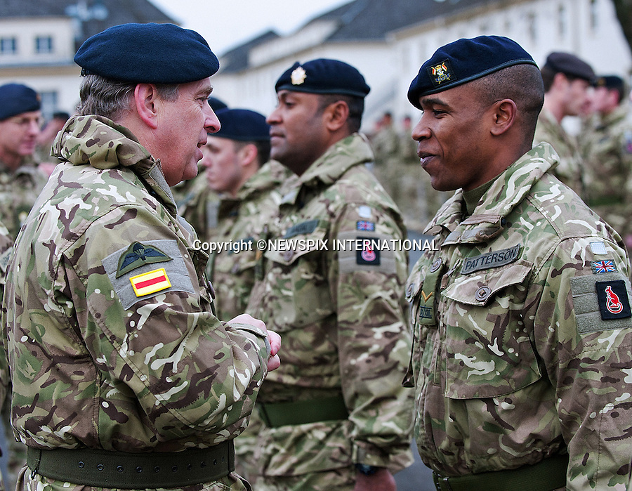 """PRINCE ANDREW.presented campaign medals to personnel from 9th/12th Royal Lancers following their return from a demanding six-month tour in Afghanistan..The Duke of York, Colonel-in-Chief of 9th/12th Royal Lancers presented medals to members of the unit during a ceremony at their home barracks in Bergen-Hohne in northern Germany before attending a specially arranged reception with military personnel and their families_08/12/2011.Photo Credit: ©Obi Igbo/Newspix International..**ALL FEES PAYABLE TO: """"NEWSPIX INTERNATIONAL""""**..PHOTO CREDIT MANDATORY!!: NEWSPIX INTERNATIONAL..IMMEDIATE CONFIRMATION OF USAGE REQUIRED:.Newspix International, 31 Chinnery Hill, Bishop's Stortford, ENGLAND CM23 3PS.Tel:+441279 324672  ; Fax: +441279656877.Mobile:  0777568 1153.e-mail: info@newspixinternational.co.uk"""