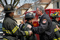 NYC mayor Bill de Blasio shakes hands with NYFD officers at the house where at least 7 children died during the fire in Brooklyn, New York. 21.03.2015. Eduardo Munoz Alvarez/VIEWpress.