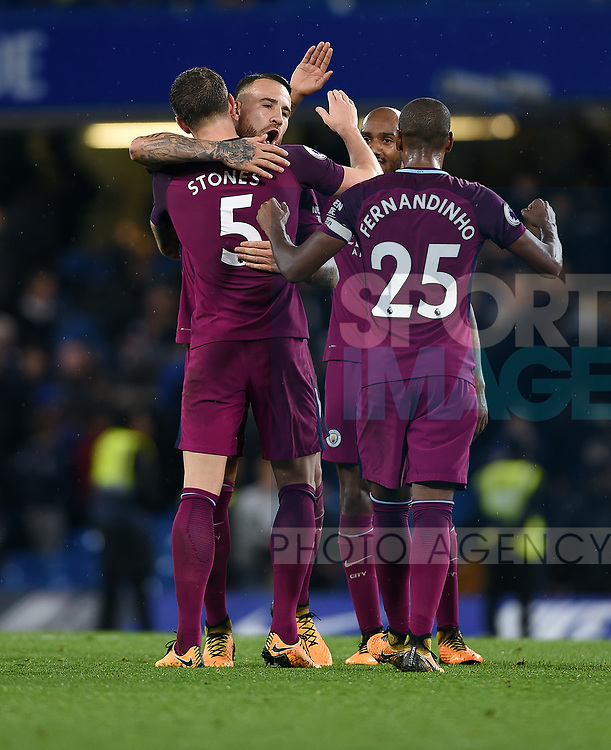Nicolas Otamendi of Manchester City celebrates with team mate John Stones of Manchester City at the end of the premier league match at the Stamford Bridge stadium, London. Picture date 30th September 2017. Picture credit should read: Robin Parker/Sportimage