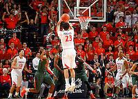 Virginia guard London Perrantes (23) shoots a three point basket during an NCAA basketball game Saturday Feb, 24, 2014 in Charlottesville, VA. Virginia defeated Miami 65-40.