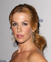 8th Annual Operation Smile Gala<br /> Los Angeles<br /> October 2 2009<br /> 8th Annual Operation Smile Gala held At The Beverly Hilton Hotel with Poppy Montgomery<br /> ID revpix91002043