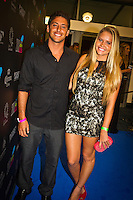 GOLD COAST, Queensland/Australia (Friday, February 24, 2012) Jeremy Flores (FRA) with girlfriend Bruna Schmitz (BRA). The 29th Annual ASP World Surfing Awards went off tonight at the Gold Coast Convention and Exhibition Centre with the worlds best surfers trading the beachwear for formal attire as the 2011 ASP World Champions were officially crowned.. .Kelly Slater (USA), 40, and Carissa Moore (HAW), 19, took top honours for the evening, collecting the ASP World Title and ASP Womens World Title respectively.. .I have actually been on tour longer than some of my fellow competitors have been alive, Slater said. All joking aside, its truly humbling to be up here and honoured in front of such an incredible collection of surfers. I want to thank everyone in the room for pushing me to where I am...In addition to honouring the 2011 ASP World Champions, the ASP World Surfing Awards included new accolades voted on by the fans and the surfers themselves...For the first time in several years, ASP Life Membership was awarded to Hawaiian legend and icon of high-performance surfing, Larry Bertlemann (HAW), 56...Where surfing is today is where I dreamed it should be in the 70s, Bertlemann said. You guys absolutely deserve this and Im so honored to be up here in front of you all tonight..Grammy Award-winning artists Wolfmother and The Vernons rounded out the nights entertainment which was all streamed LIVE around the world on YouTube.com..Photo: joliphotos.com