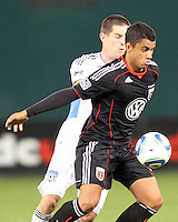 Junior #30 of D.C. United shields the ball from Sam Cronin #4 of the San Jose Earthquakes during an MLS match at RFK Stadium in Washington D.C. on October 9 2010. San Jose won 2-0.