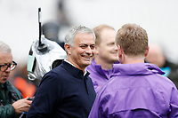 23rd November 2019; London Stadium, London, England; English Premier League Football, West Ham United versus Tottenham Hotspur; Tottenham Hotspur Manager Jose Mourinho sharing a joke with his staff as he arrives at the touchline before kick off - Strictly Editorial Use Only. No use with unauthorized audio, video, data, fixture lists, club/league logos or 'live' services. Online in-match use limited to 120 images, no video emulation. No use in betting, games or single club/league/player publications