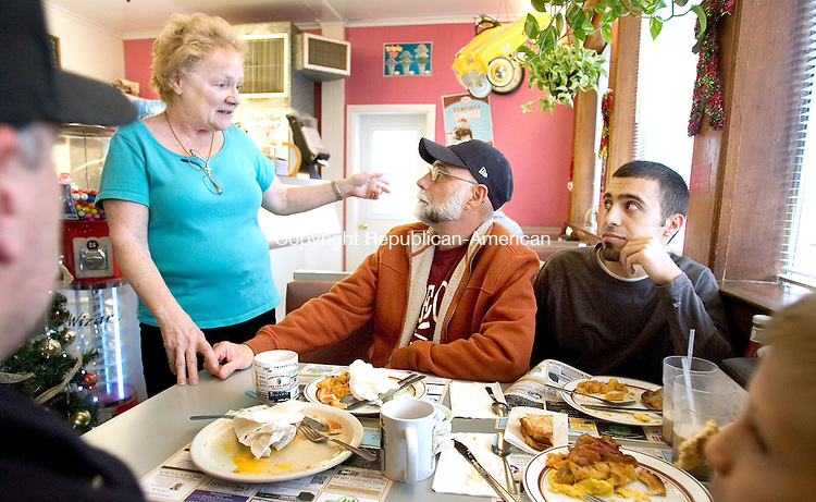 PROSPECT CT. 05 December 2014-120614SV09-From left, Carol Jones, owner, talks with regulars, Bill Vail of Prospect and his grandson Jason Vail of Prospect at the Prospect Dairy Bar in Prospect Saturday. It's the 65th anniversary of the restaurant, which is a local staple. Even though it's changed ownership over the years, the restaurant has maintained its reputation for providing classic American diner food. <br /> Steven Valenti Republican-American