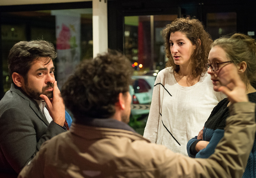"Members of the audience and theatre group in the reception area of Salle Louis Jouvet following a performance by  Marie-Charlotte Dracon in the solo dual acting role as Elisewin and Père Pluche in a 40 minute play titled Elisewin et Pluche, performed at the Town Hall in Rouen, France on Wednesday 12th November 2014 as part of the festival Z'azimuts, and on Thursday 13th November at the theatre Salle Louis Jouvet, 153 rue Albert Dupuis, Rouen. The play was conceived and written by Amelie Chalmey, in conjunction with Marie-Charlotte Dracon, based on the book by Italian author Alessandro Baricco ""Océan Mer"" first published in 1993. Thursday 13th November 2014."