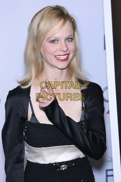 "THORA BIRCH.AFI Fest 2006 by Audi Presents ""Dark Corners"" Premiere - Arrivals held at the ArcLight, Hollywood, California, USA,10 November 2006..half length black dress shrug red lipstick hand gesture pointing.Ref: ADM/ZL.www.capitalpictures.com.sales@capitalpictures.com.©Zach Lipp/AdMedia/Capital Pictures."