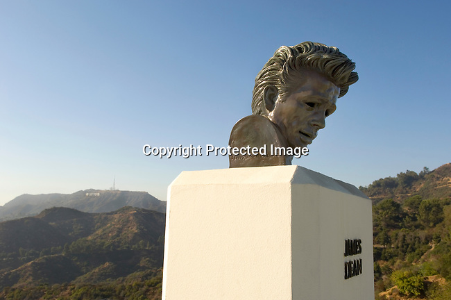 James Dean staue with the Hollywood Sign in background, outside of the Griffith Park Observatory, Los Angeles, CA