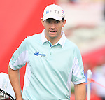 Padraig Harrington walks onto the 1st tee to start his back 9 during Thusday Day 1 of the Abu Dhabi HSBC Golf Championship, 20th January 2011..(Picture Eoin Clarke/www.golffile.ie)