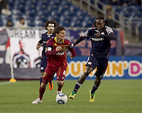Real Salt Lake midfielder Will Johnson (8) dribbles as New England Revolution midfielder Shalrie Joseph (21) pressures. In a Major League Soccer (MLS) match, Real Salt Lake defeated the New England Revolution, 2-0, at Gillette Stadium on April 9, 2011.