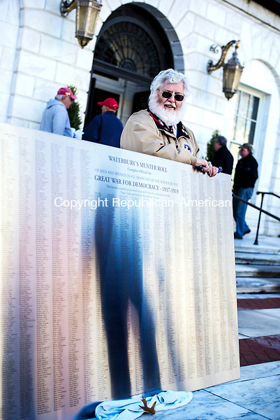Waterbury, CT- 11 November 2016-111116CM01- Jack Shea, with the Waterbury Veterans Memorial Committee who also served with the U.S Army, holds onto a new memorial sign during a Veterans Day ceremony at Waterbury City Hall on Friday.     Christopher Massa Republican-American
