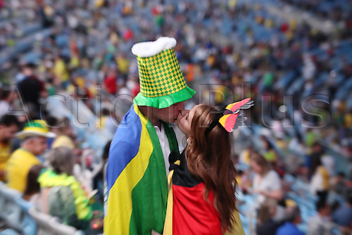 05.08.2016. Rio de Janeiro, Brazil.  Spectators wearing a Brazilian and a German (r) flag exchange a kiss prior to the opening ceremony of the Rio 2016 Olympic Games at the Maracana stadium in Rio de Janeiro, Brazil, 5 August 2016.
