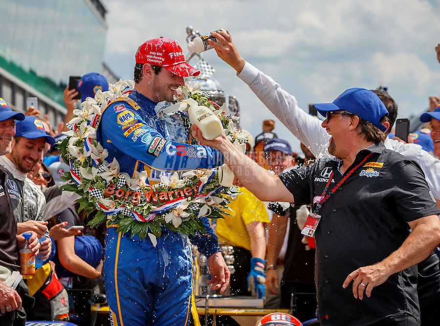 May 29, 2016; Indianapolis, IN, USA; IndyCar Series driver Alexander Rossi (left) is doused with milk by team owner Michael Andretti as they celebrate after winning the 100th running of the Indianapolis 500 at Indianapolis Motor Speedway. Mandatory Credit: Mark J. Rebilas-USA TODAY Sports