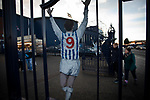 Supporters walking through the Astle gates at the entrance to the stadium before West Bromwich Albion take on Leeds United in a SkyBet Championship fixture at the Hawthorns. Formed in 1878, the home team were relegated from the English Premier League the previous season and were aiming to close the gap on the visitors at the top of the table. Albion won the match 4-1 watched by a near-capacity crowd of 25,661.