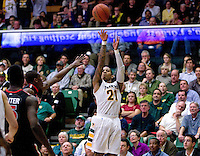 De'End Parker of USF shoots the ball during the game against St. John's at War Memorial Gym in San Francisco, California on December 4th, 2012.   USF Dons defeated St. John's, 81-65.