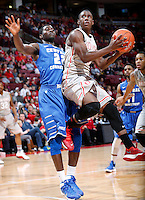 Ohio State Buckeyes guard Shannon Scott (3) is fouled by Central Connecticut State Blue Devils forward Faronte Drakeford (22) as he goes up for a basket in the first half of the college basketball game between the Ohio State Buckeyes and the Central Connecticut State Blue Devils at Value City Arena in Columbus, Saturday afternoon, December 7, 2013. As of half time the Ohio State Buckeyes led the Central Connecticut State Blue Devils 38 - 29. (The Columbus Dispatch / Eamon Queeney)